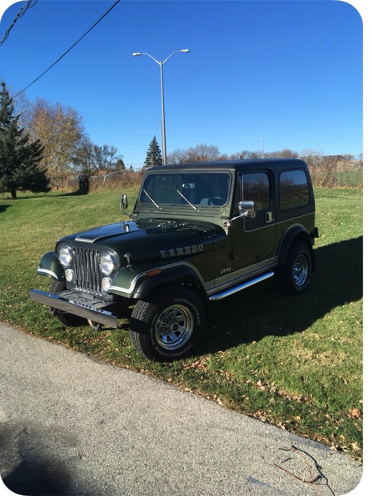 83 jeep CJ7 Laredo restored in factory sherwood forest green