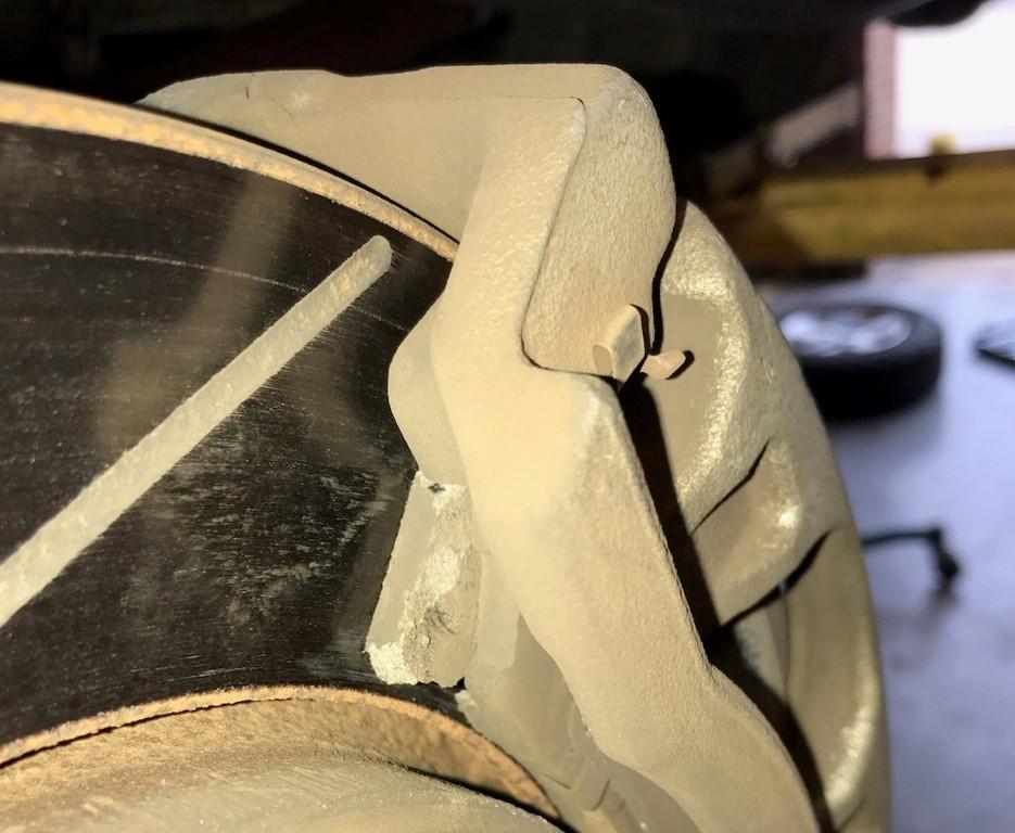 Broken_Brake_Pad1.jpg