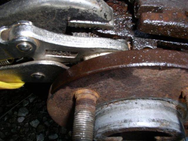 2_E-brake_vise_grips_on_both_cam_lever_up_close_-_R_Medium_.JPG